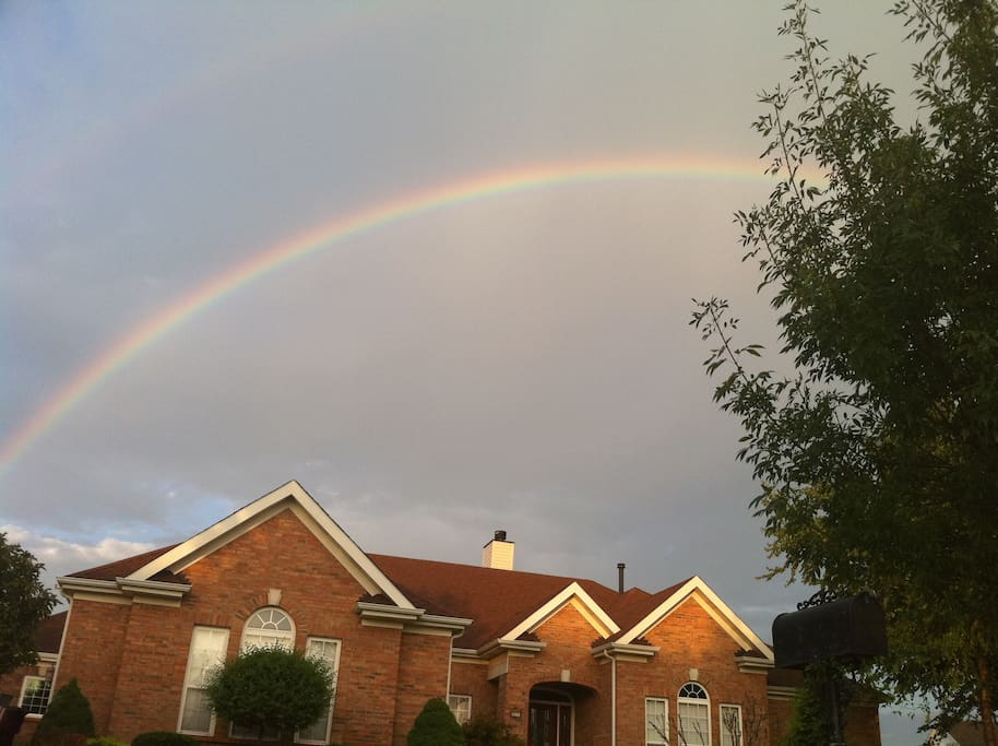 A pic that i found of the front of our home with a rainbow.