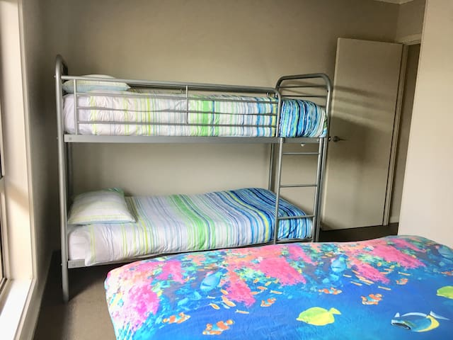 Second bedroom with double bunk and Queen bed is great for families