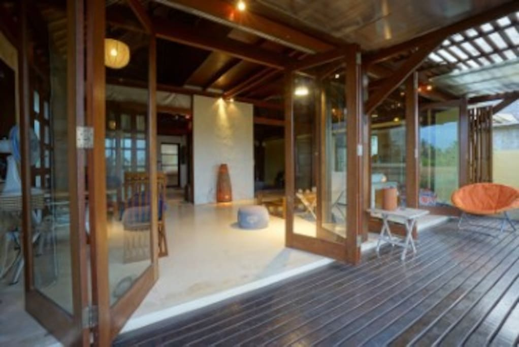 Wall of doors open to the deck and view