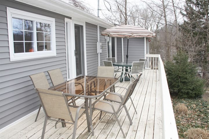 Large deck with outdoor tables and chairs