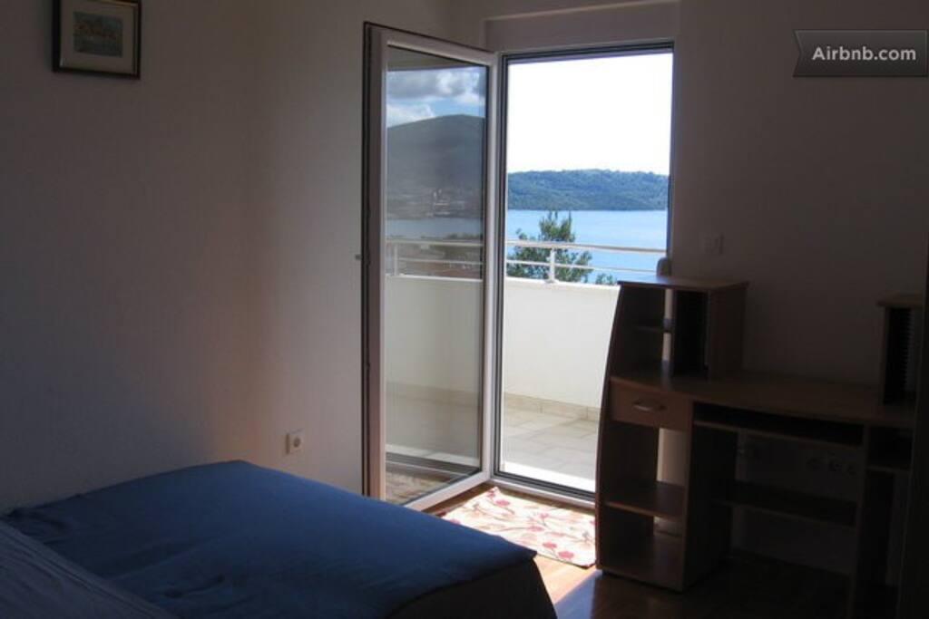 Bedroom with door onto Balcony
