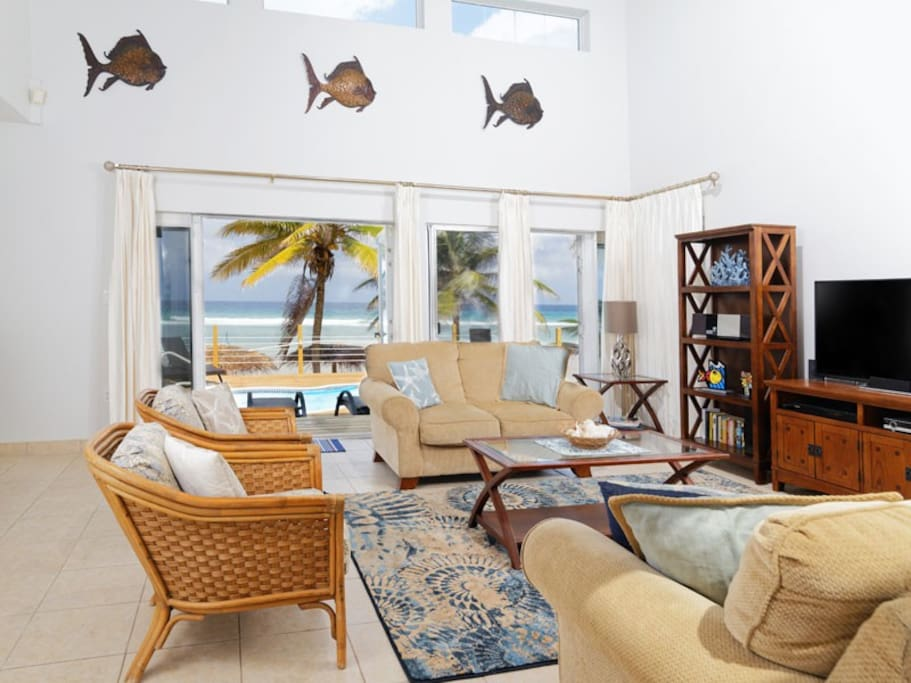 Living Room with French Doors to Deck and Pool and Beach