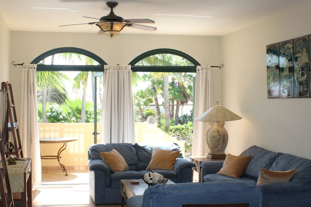 Living Room with beautiful view of palm trees and gardens