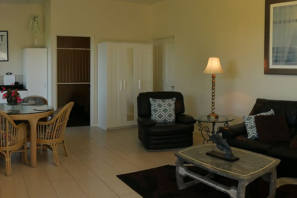 Dining and living areas with large flatscreen TV with cable, plus Wifi internet.
