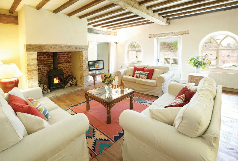Ground floor: Sitting room with inglenook fireplace and wood burner
