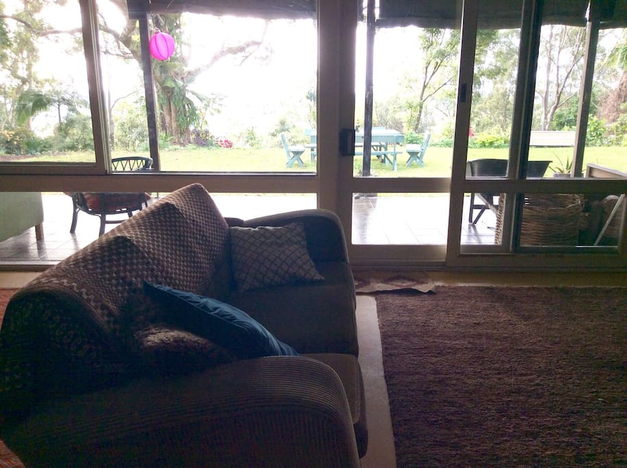 Living room opens to verandah, garden, cool Easterly breezes and views