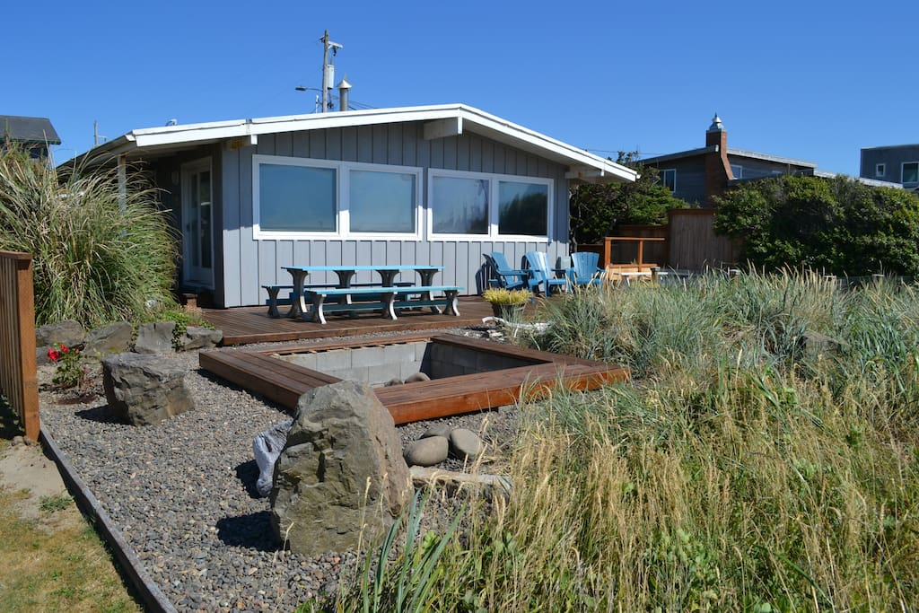 View of Oceans Doorstep from beach - large wrap around deck with built in hot tub and fire pit.