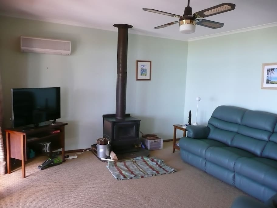 Comfortable recliners, wood fire and wide screen TV