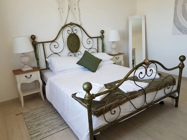 The main bedroom with large double bed.