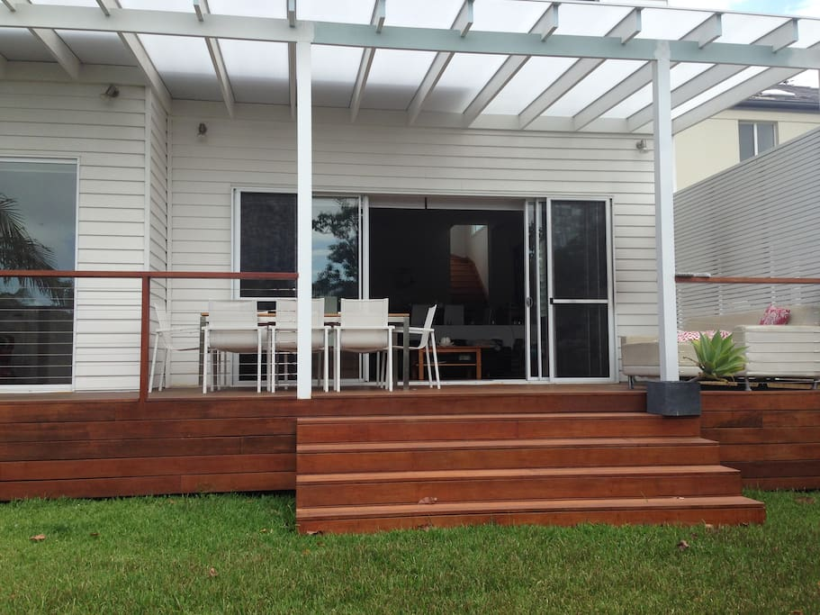 Covered backyard deck entertaining area. Faces north beautiful sea breezes.