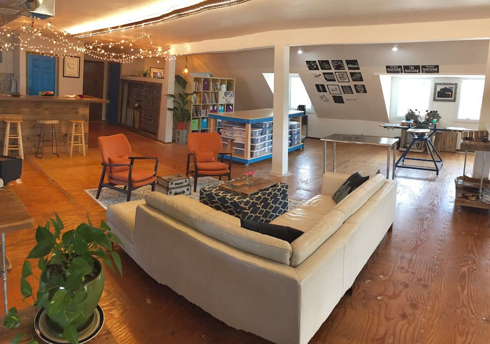 Our Artist loft has plenty of space to spread out and relax! Cozy couch, comfy chairs, 2 large work tables, and a desk.