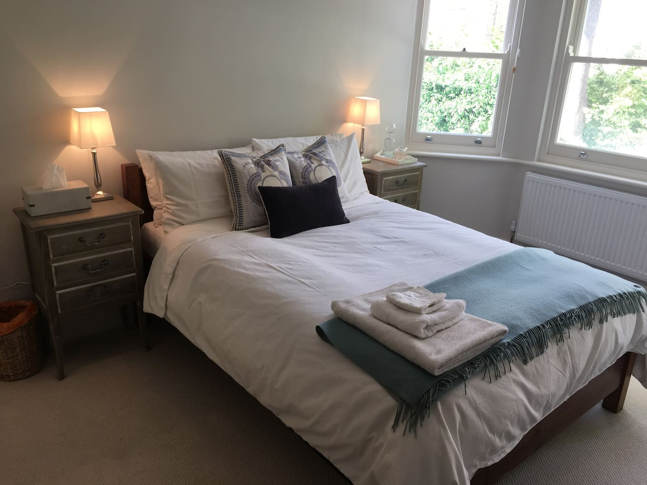 A relaxing, bright and stylish room, with windows facing out onto gardens and trees. The room is very quiet, with very little outside noise. It has three large windows and lots of natural light. Sometimes you can even see squirrels in the trees outside.