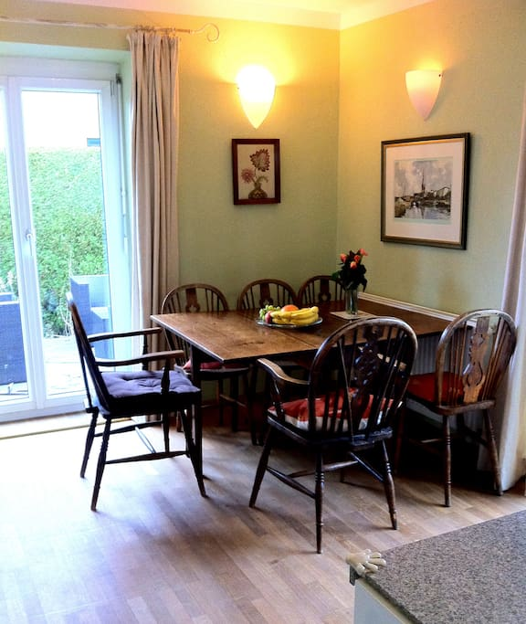 Diningroom seats six with french doors to enclosed terrace.