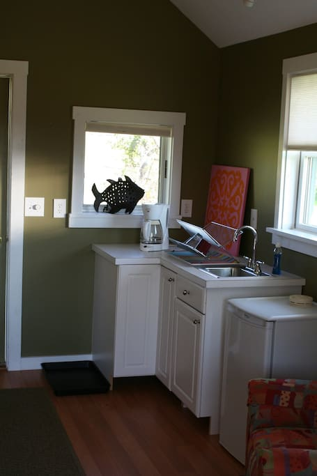 Refrigerator, coffee maker, sink for some comforts of home.