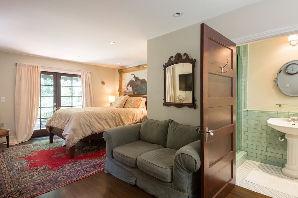 Queen size bed, couch in suite