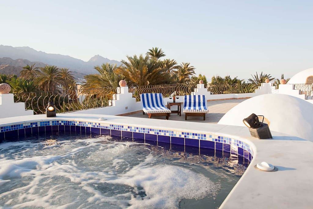 Fabulous rooftop, hand tiled Jacuzzi with its incredible 360 views of the Red Sea and Sinai mountains.  Perfect place for that sundowner!