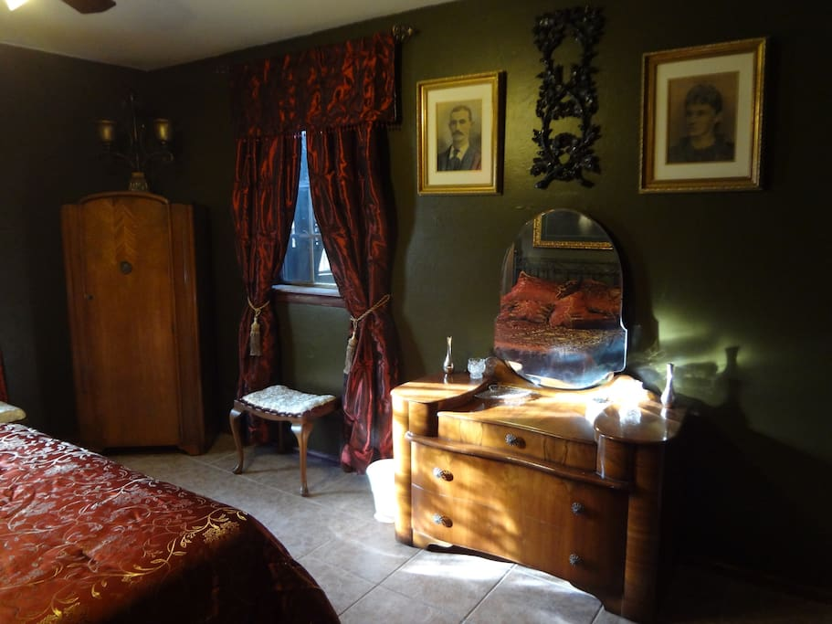 The master bedroom is here to spoil you, filled with antiques and interesting local artifacts. (Image #2