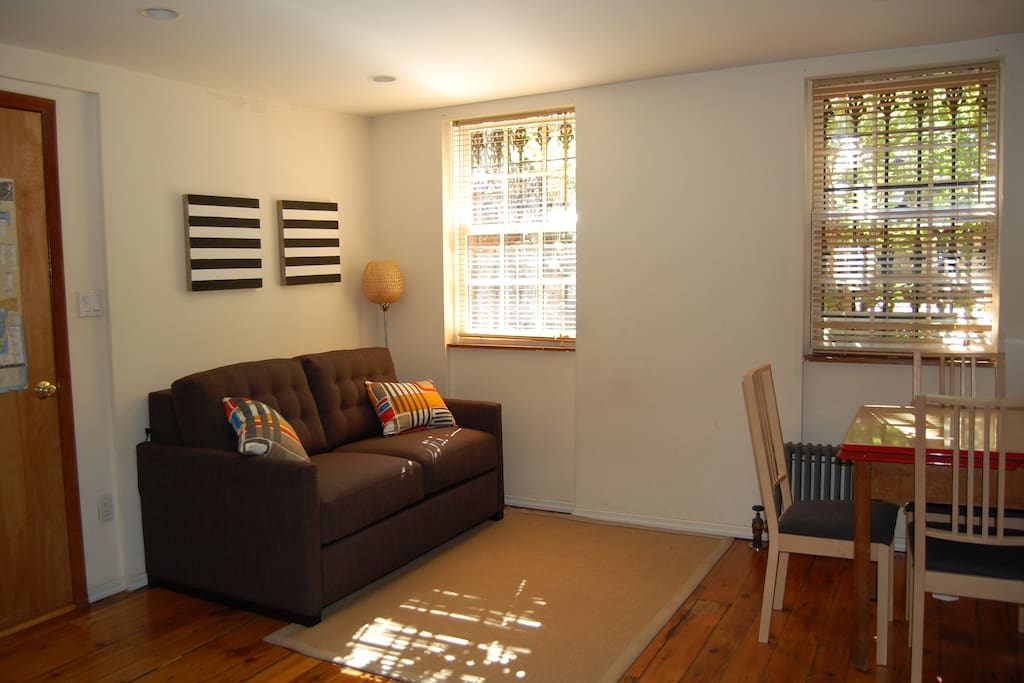 Living room with pull out sofa, dining table and 4 chairs
