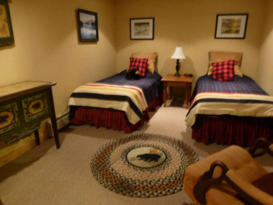 Same rentable lower level guest room with beds set up as twins