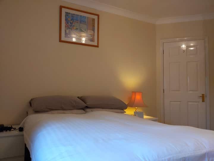 Newgate Street Village bedroom with en suite