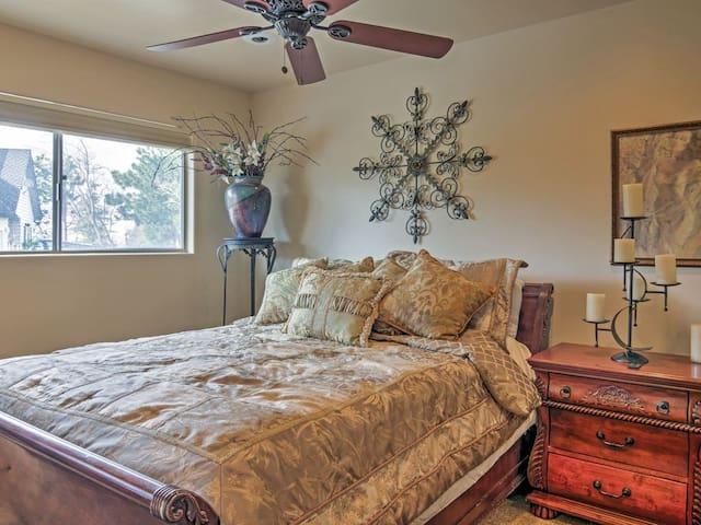 Main floor guest bedroom with queen bed, dresser, nightstand and plenty of closet space