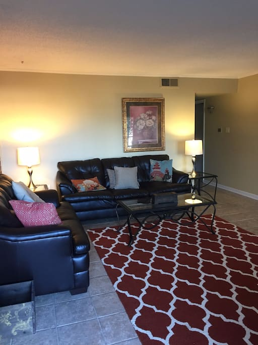 Large living room area with comfy sofas