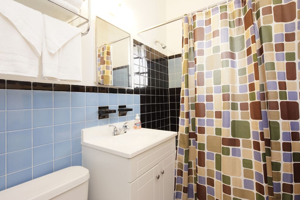Full bathroom with tub/ shower