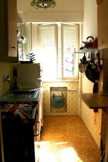 kitchen with gas oven, large fridge