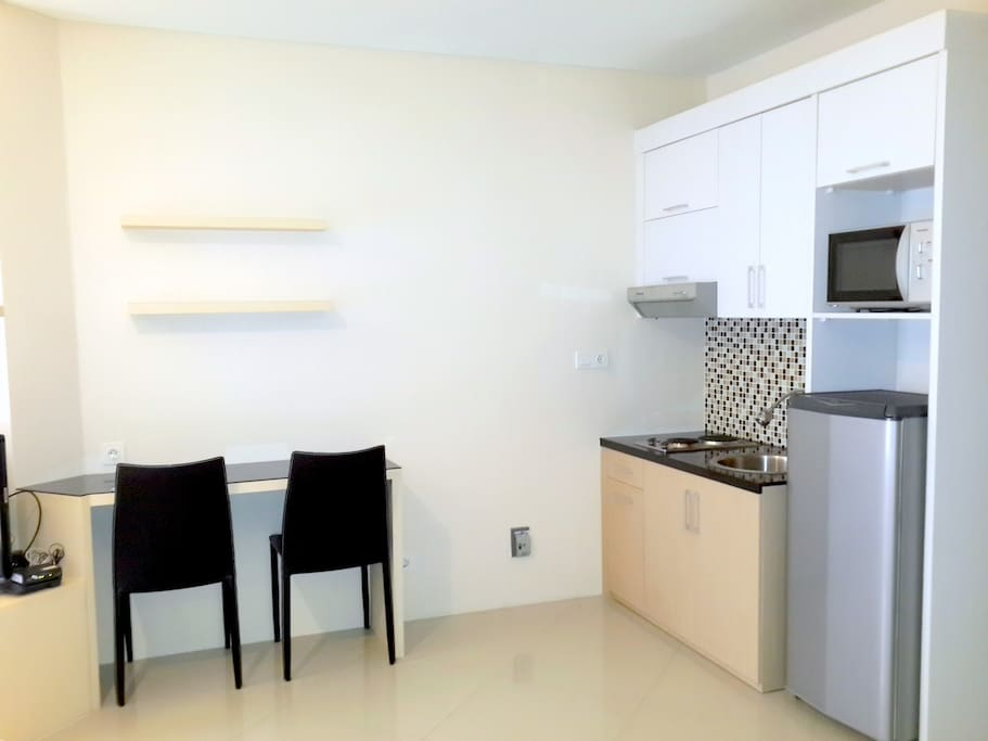 Kitchen (with Microwave and Refrigerator)  and Dining Tables
