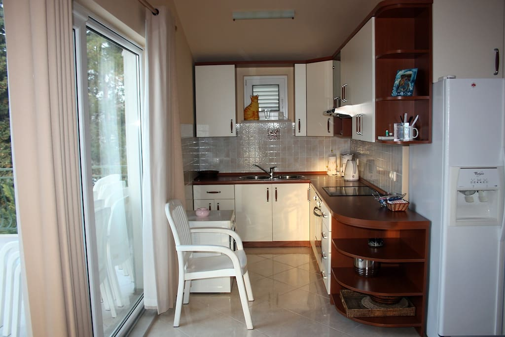 Fully equiped kitchen right next to the major terrace