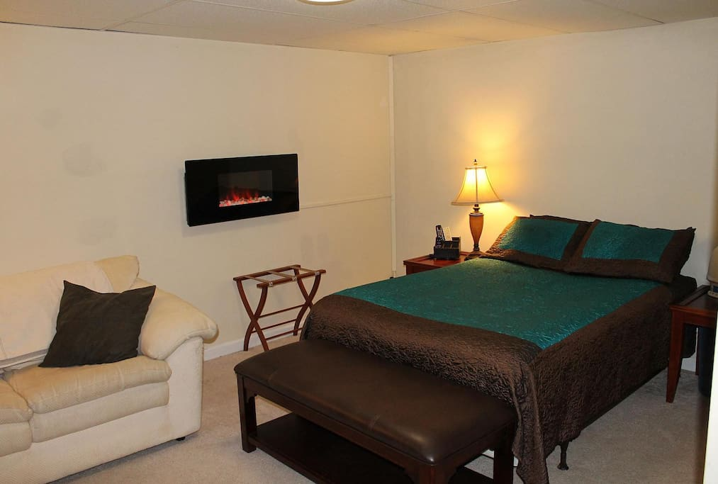 Large bedroom suite, queen bed, electronic fireplace.  LED TV.