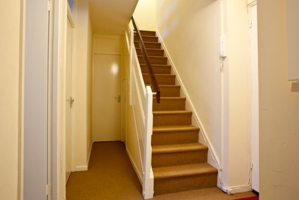 Stairs up to kitchen and full bathroom ½ bath at end of hall