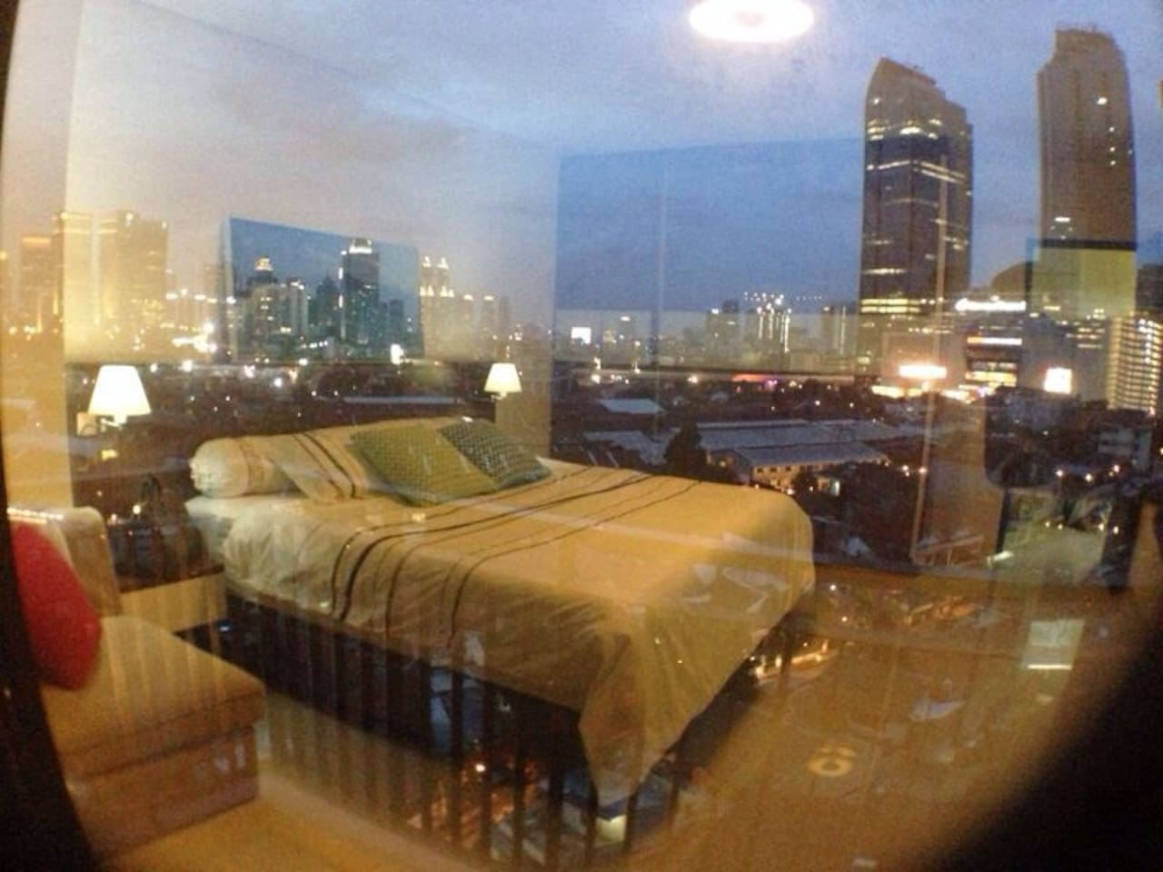 city view and reflection of the bedroom