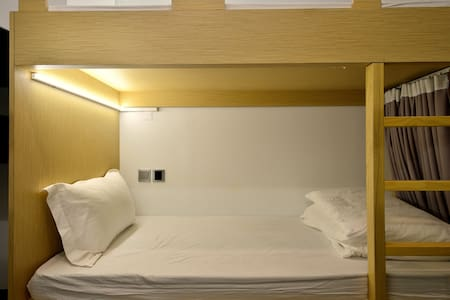 Each bunk space includes a personal reading light & charging port
