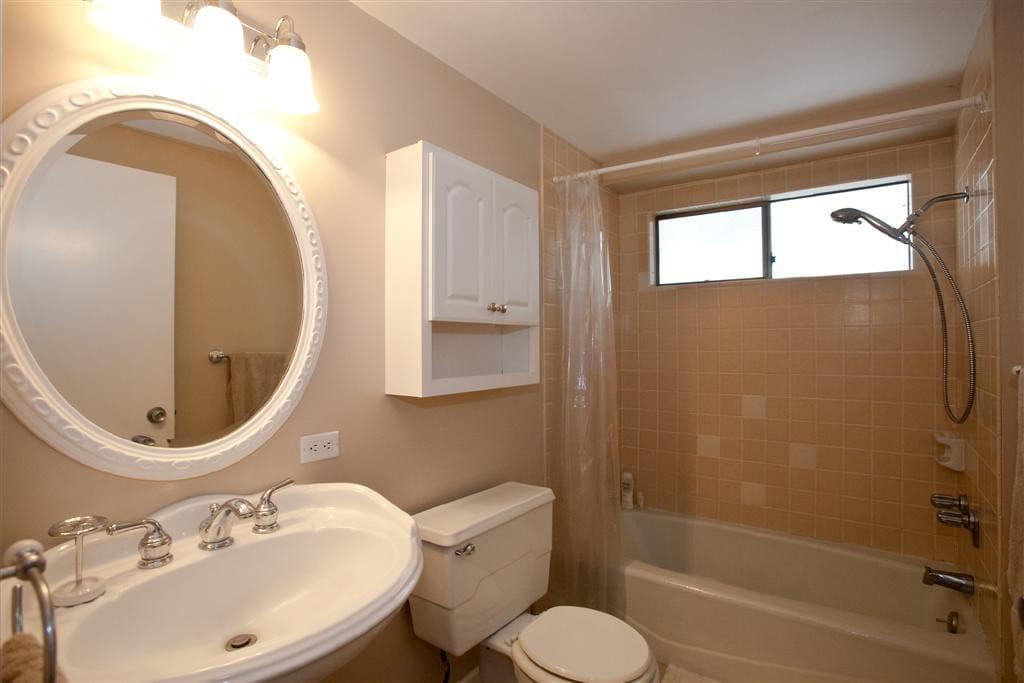 Quaint Bathroom with Shower Tub