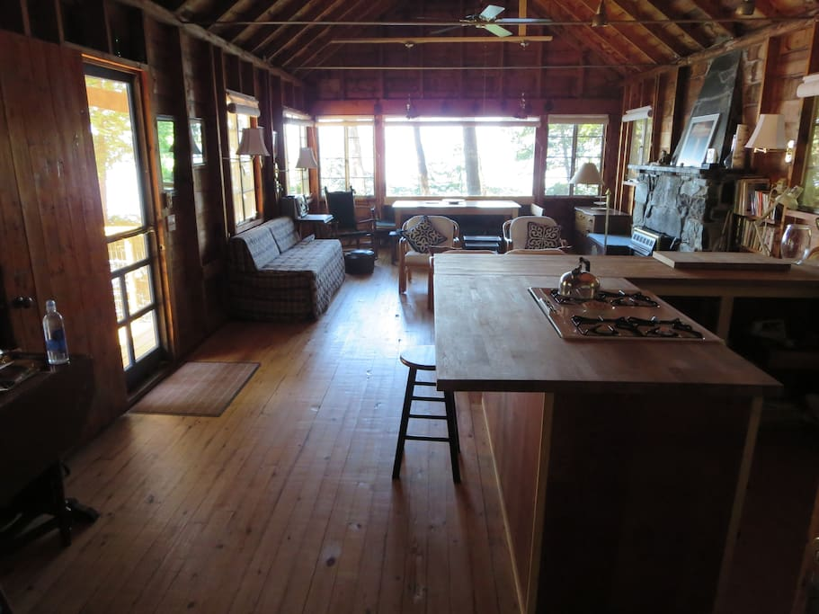 The great room and kitchen with lake and Adirondack views