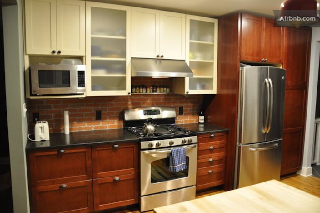 Nice new kitchen with all the amenities, including a gas-burning range.