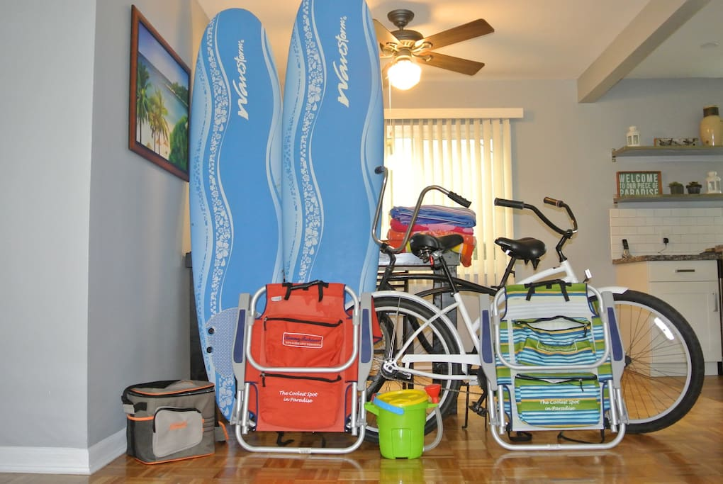 Beach Chairs, Bikes, Cooler, Beach Toys, Beach Towels, and Surfboards All Included