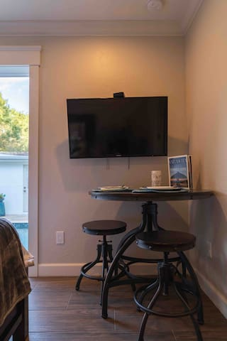 Inside Bungalow Bistro Dining Table and Smart TV