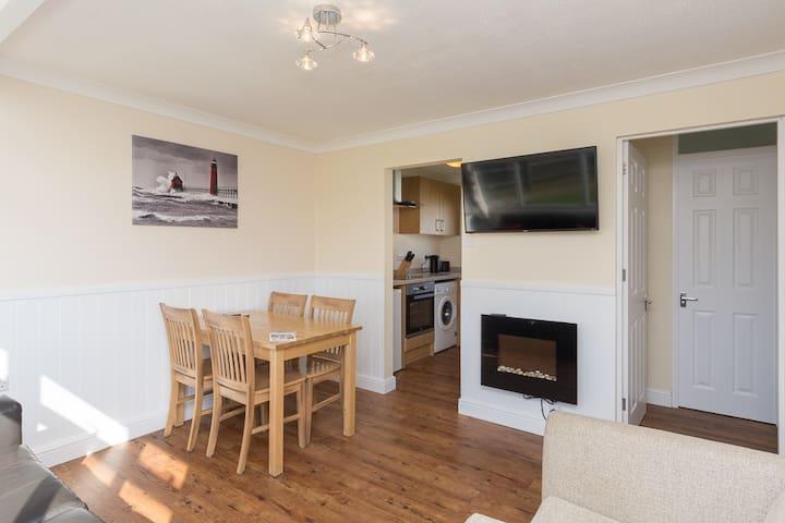 Spacious open plan sitting/dining/kitchen areas