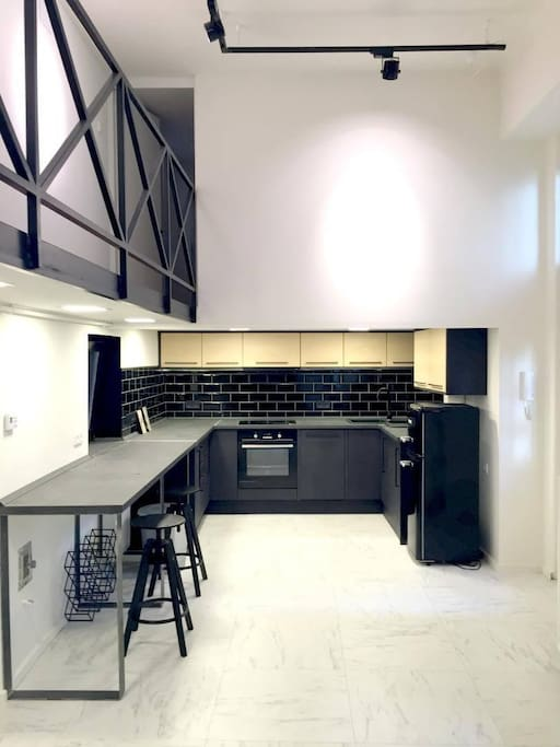Kitchen with all equipments dish washer ,refrigerator ,oven ...