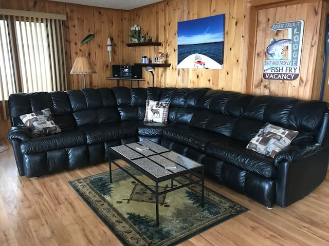 """Living room with huge sectional, wood burning stove (bring wood) and another sofa w/50"""" flatscreen w/Charter Cable & WiFi throughout whole home and property!"""