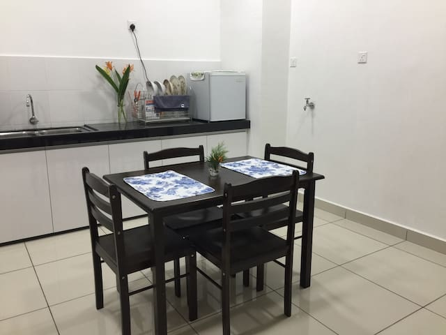Dinning area •dinning table and chairs •tablewares •refrigerator