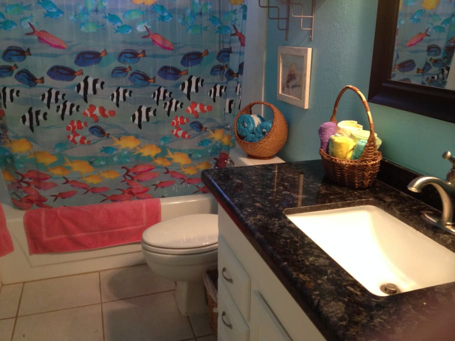 Guest bathroom with oceanic theme.