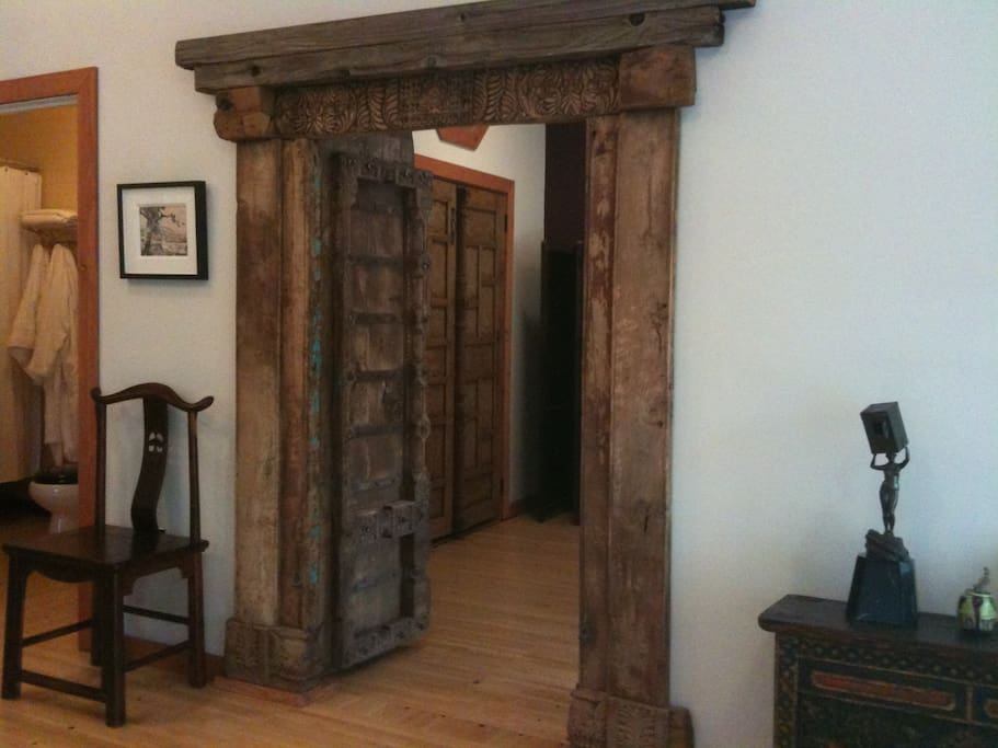 350 year old salvaged Indian door leading from the living room to the bedroom.