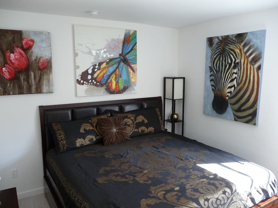 BED AND PAINTINGS