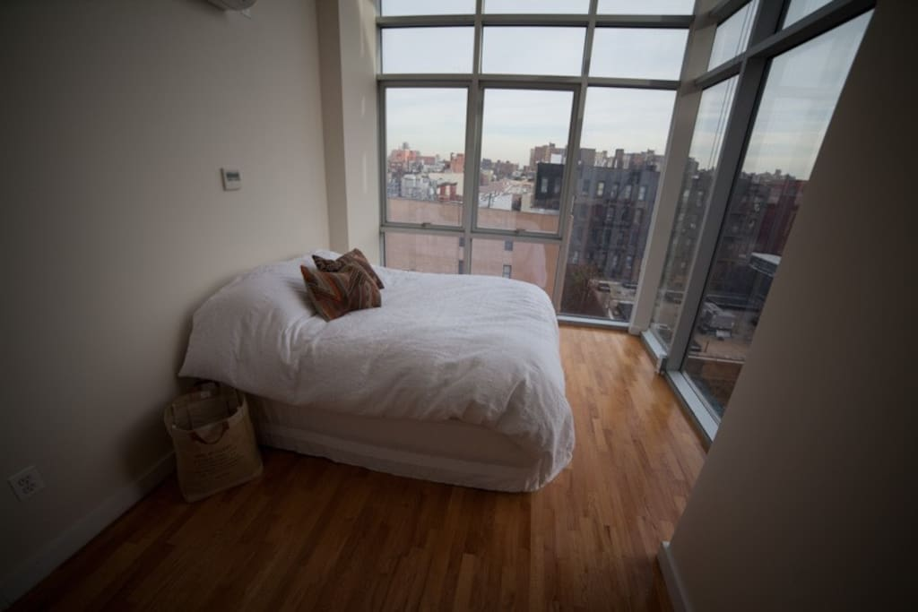 Your bedroom - watch all of NY from here and sleep comfortably in a luxurious down comforter.