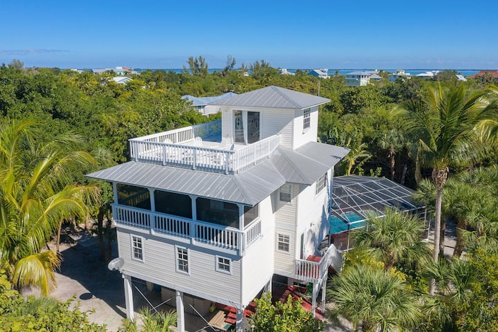 NEW PROPERTY: Upscale Beach Home with Screened-in Pool, Hot Tub, Outdoor Kitchen