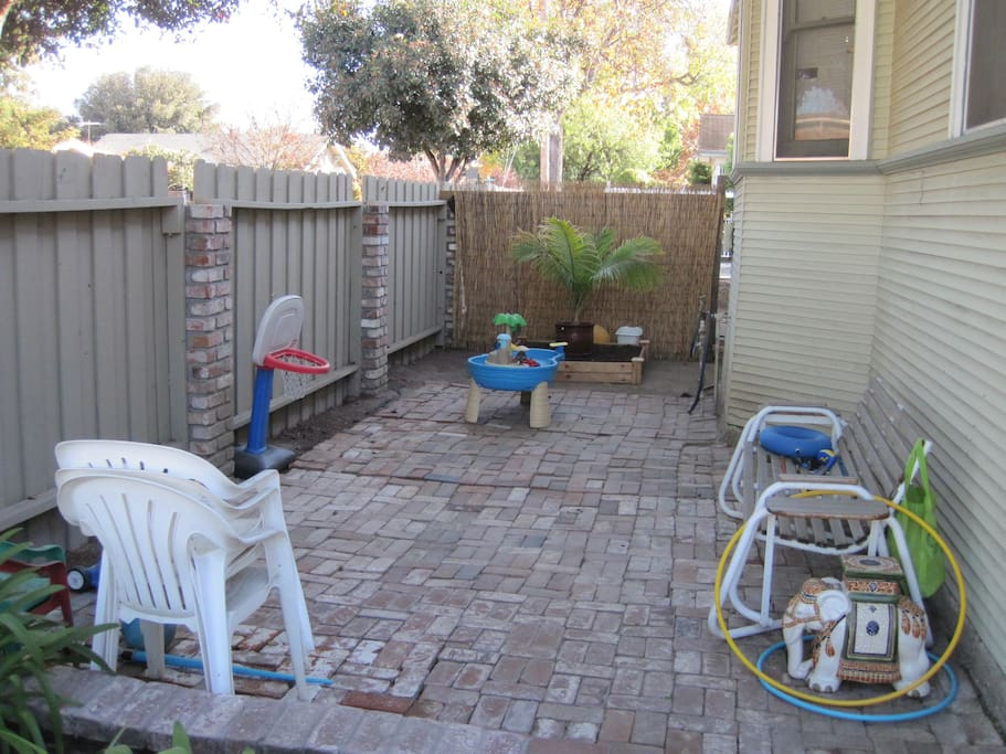 Brick patio on side of the house. Gas BBQ available for use.