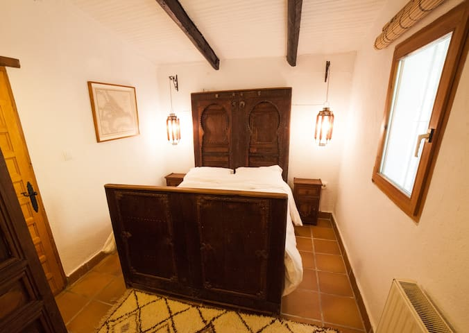 Bedroom two in main house with double bed and en suite bathroom